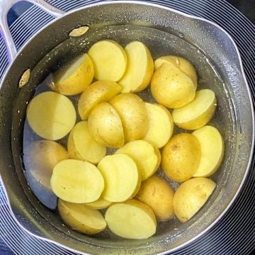 Potatoes boiling in a saucepan.