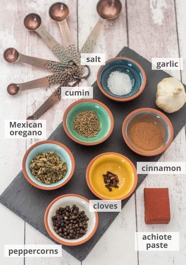 Ingredients for recado rojo: garlic, cinnamon, cloves, achiote paste, peppercorns, Mexican oregano, cumin seed, salt. This marinade/paste is the basis for cochinita pibil.