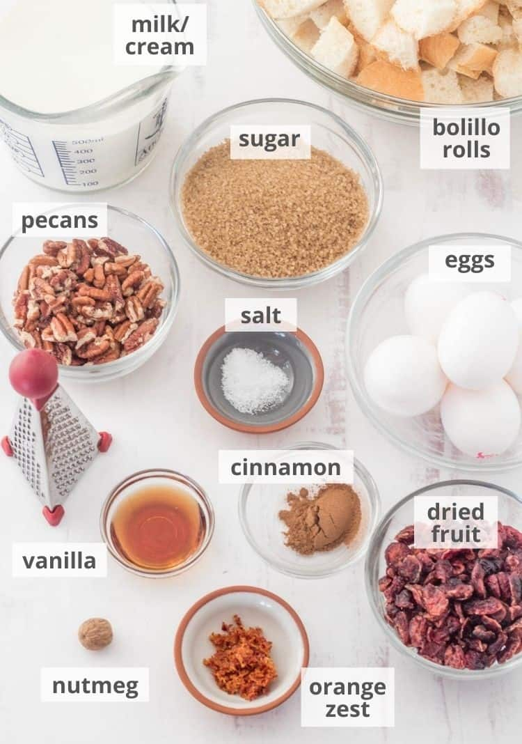 Ingredients for the bread pudding in prep bowls on a white background.