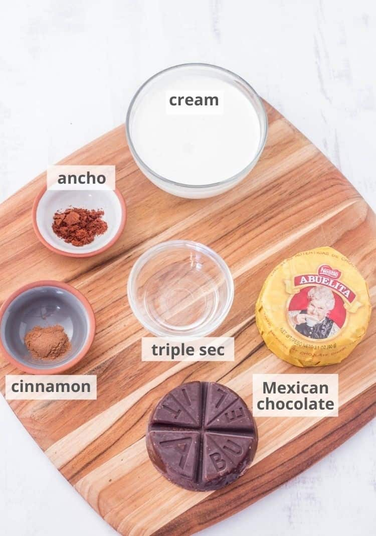 Ingredients for the boozy Mexican chocolate sauce on a wood cutting board.
