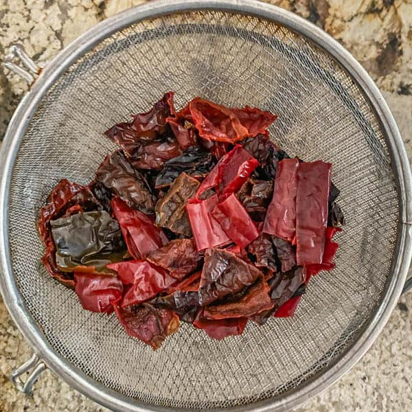Toasted red chiles, rehydrated and drained.