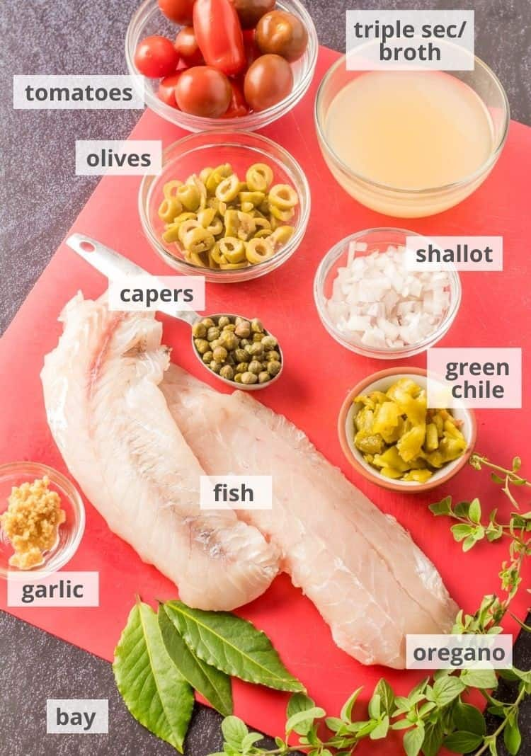 Ingredients for fish Veracruz: Speckled trout, Hatch green chile, olives, capers, triple sec, broth, garlic, bay oregano, tomatoes.