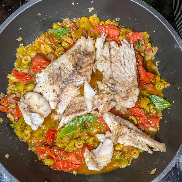 The completed speckled trout Veracruz in the sauté pan before plating.