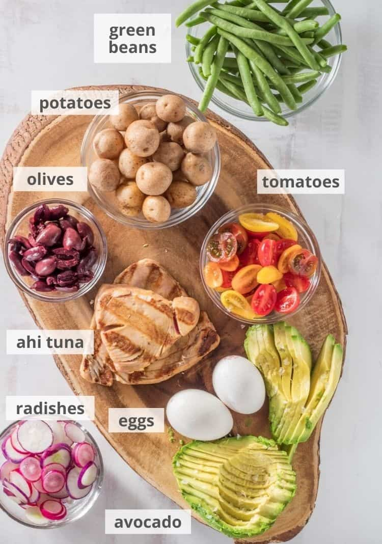 Ingredients for the composed Nicoise salad: Ahi tuna, eggs, avocado, radishes, tomatoes, olives, potatoes, green beans.