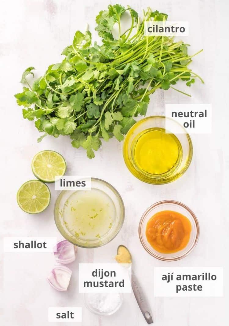 Ingredients for cilantro-lime dressing: Oil, aji amarillo paste, dijon mustard, salt, shallot, limes, cilantro.