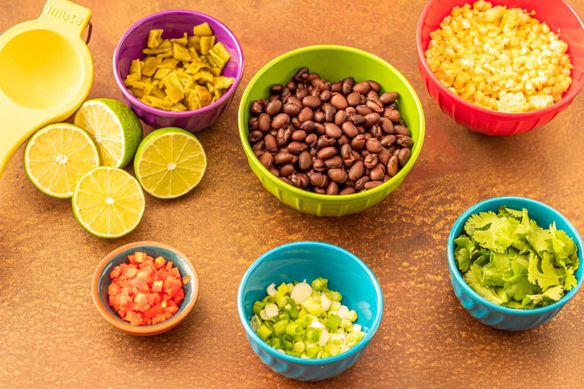 Ingredients for the grilled corn and black bean salsa prepped and in bowls before mixing.