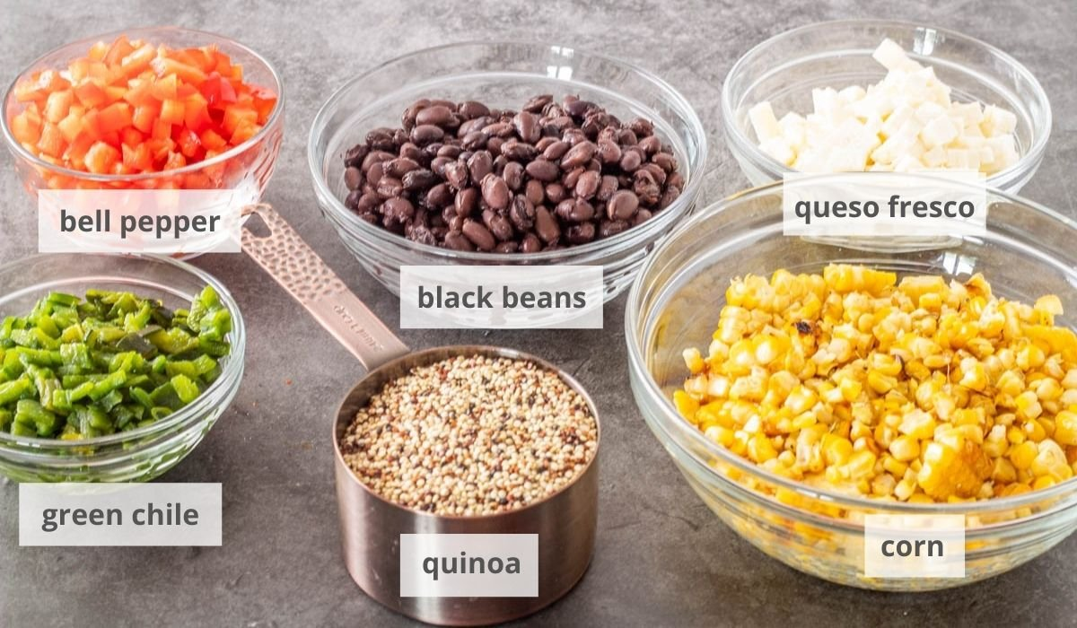 The black bean and quinoa salad ingredients - bell pepper, black beans, queso fresco, corn, quinoa, and green chile.
