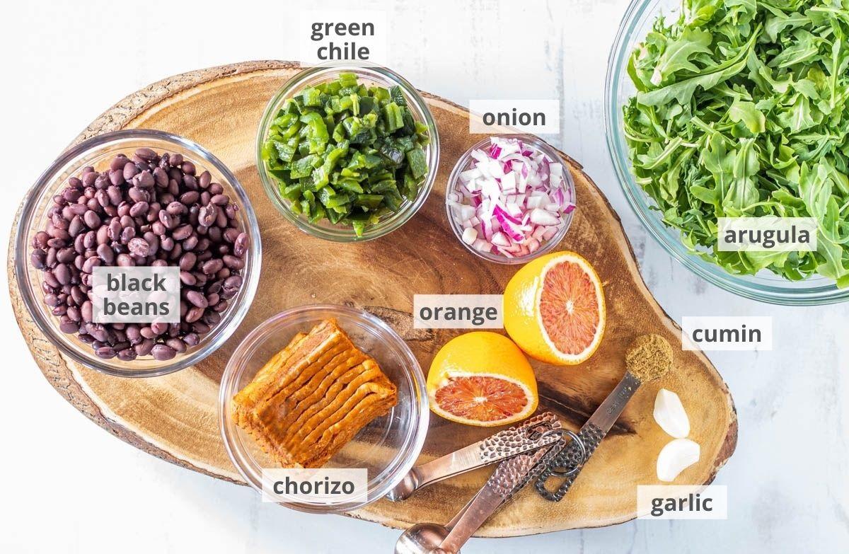 Ingredients for the black beans: Black beans, Hatch green chile, onion, arugula, cumin, garlic, orange, chorizo.