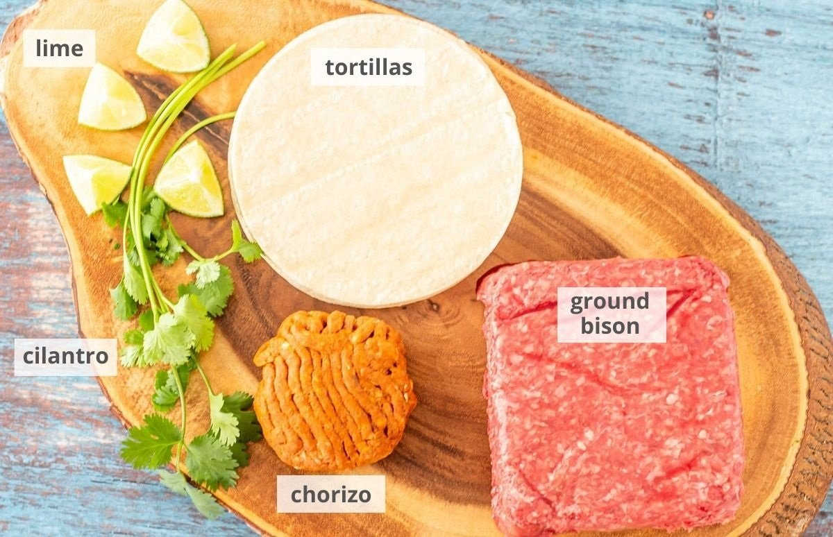 Ingredients for bison tacos: Ground bison, lean Mexican chorizo, corn tortillas, lime wedges, and fresh cilantro.
