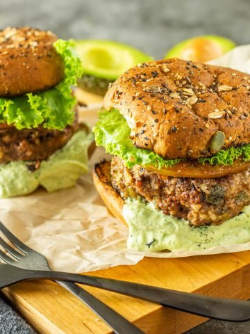 2 healthy bison burgers with Hatch green chile and all the fixings.