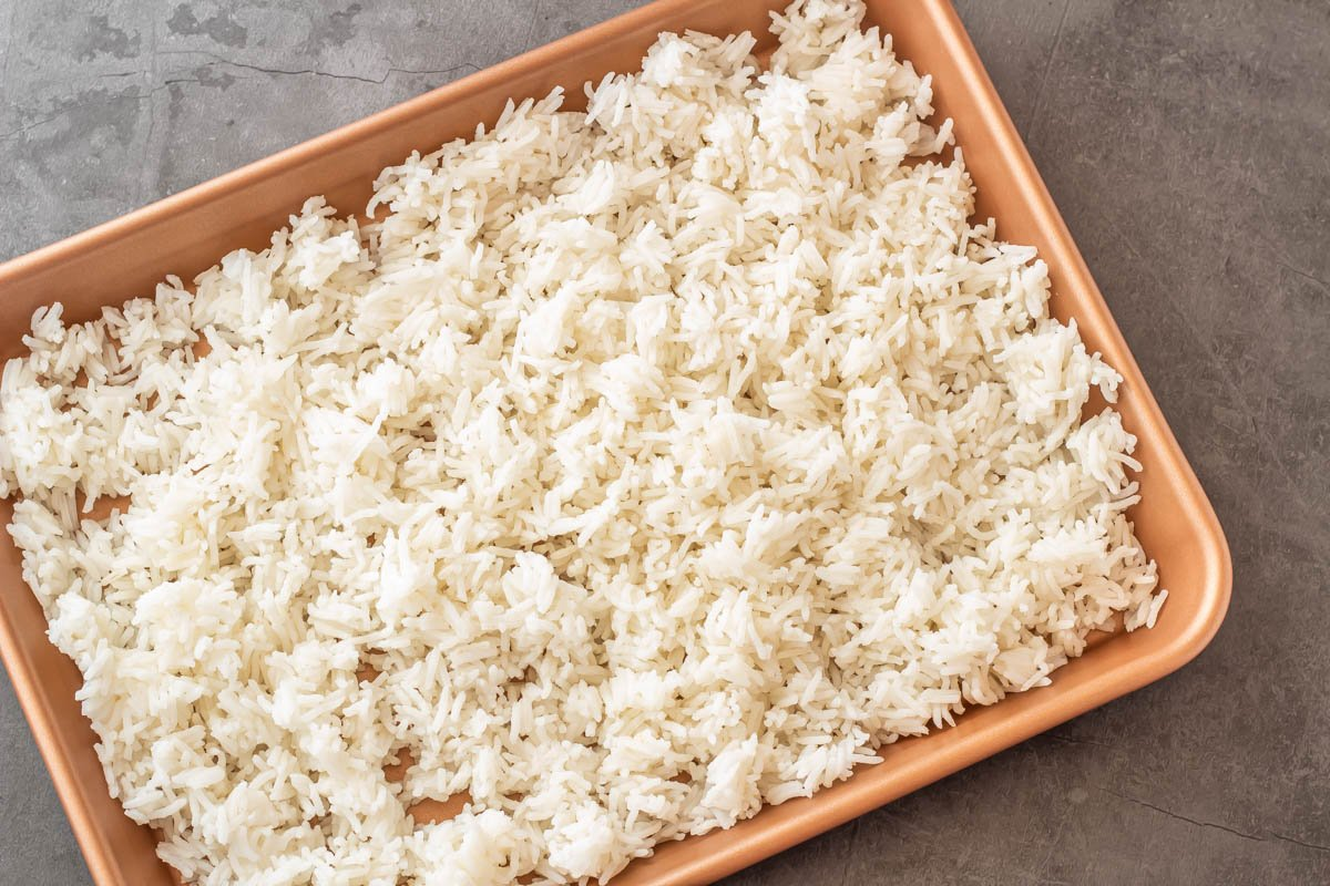 A baking sheet with white rice.